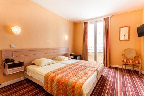 Ein Bett oder Betten in einem Zimmer der Unterkunft Malecot Boutique Hotel
