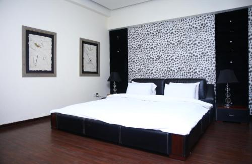 A bed or beds in a room at Safari Club 1