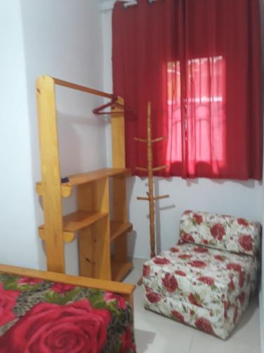 Uma área de estar em Vila Aquario da Sonia