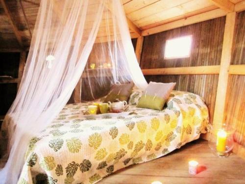 Un ou plusieurs lits dans un hébergement de l'établissement les cabanes du lac du der