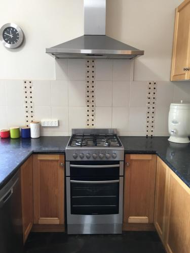A kitchen or kitchenette at Apostle Hideaway - Central Port Campbell