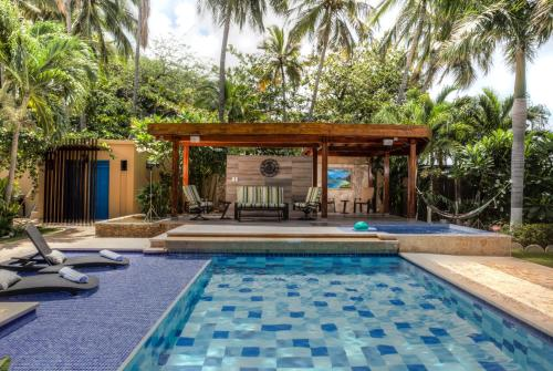 The swimming pool at or near Casa Verano Beach Hotel - Adults Only