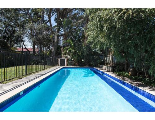The swimming pool at or near Comfy family home in chill beachside neighbourhood