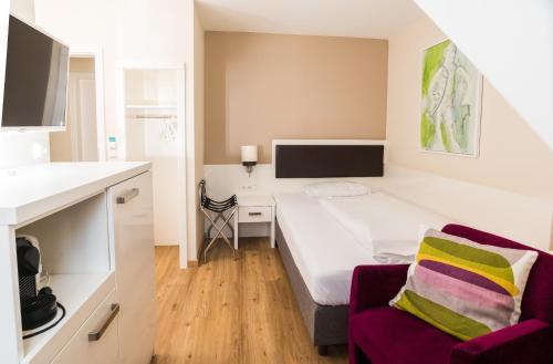 Ein Bett oder Betten in einem Zimmer der Unterkunft Remise Thurn