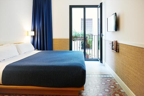 Een bed of bedden in een kamer bij Hotel Casa Bonay