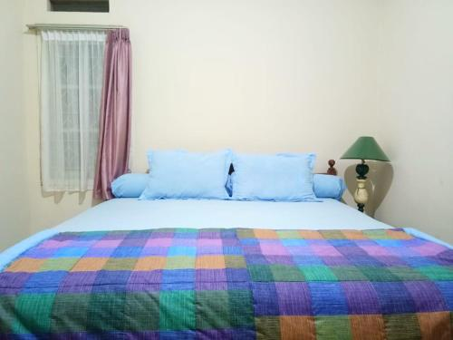 A bed or beds in a room at My Lady One Villa - Hansel Group