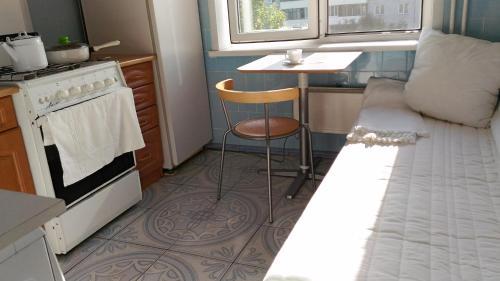 A kitchen or kitchenette at Апартамент Юстис