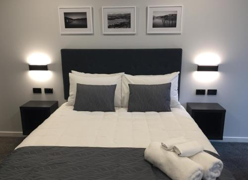 A bed or beds in a room at The Studio Akaroa