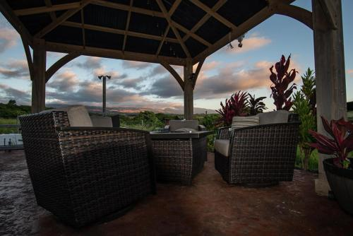 A porch or other outdoor area at God's Peace of Maui