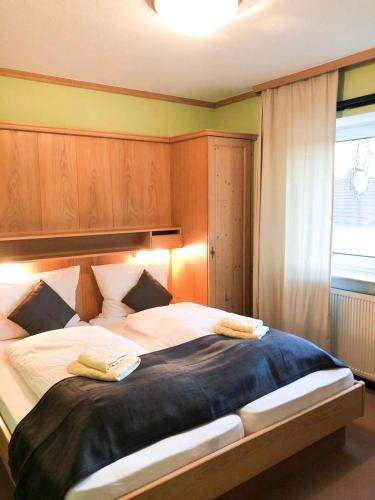 A bed or beds in a room at Altes Sudhaus