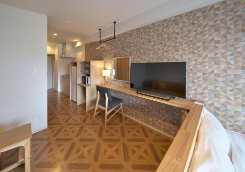 A television and/or entertainment center at e-stay ebisu