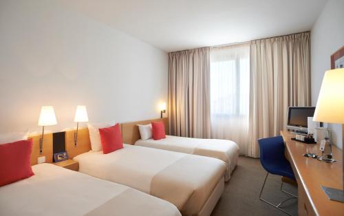 A bed or beds in a room at Novotel Barcelona Sant Joan Despí
