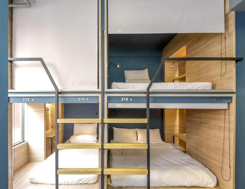A bunk bed or bunk beds in a room at DONGMEN 3 Hostel