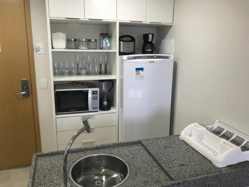A kitchen or kitchenette at Flat Paiva Home Stay