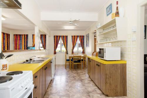 A kitchen or kitchenette at Wheelchair Friendly with water views - Welsby Pde, Bongaree