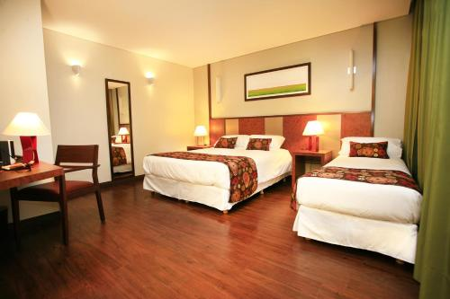 A bed or beds in a room at 1412 Hotel Boutique