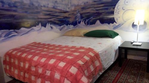 A bed or beds in a room at Ottawa Backpackers Inn