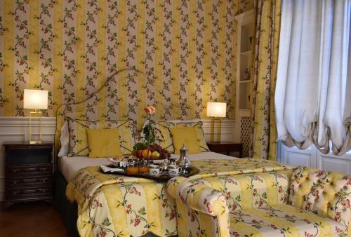 Letto o letti in una camera di Palazzina Mori - Luxury B&B