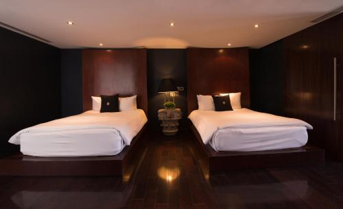 A bed or beds in a room at Demetria Hotel