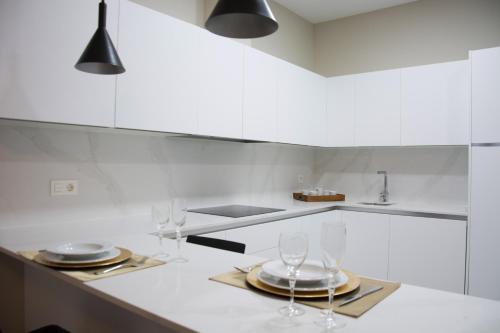 Una cocina o zona de cocina en Apartamentos Alaia