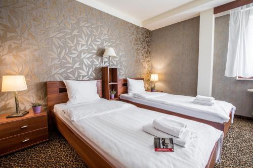Un ou plusieurs lits dans un hébergement de l'établissement Hotel Diament Vacanza Katowice - Siemianowice