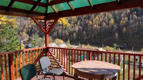 A balcony or terrace at Baykal`skiy Domik Guest House