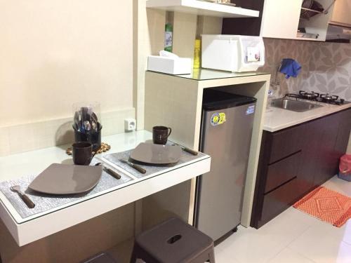 A kitchen or kitchenette at Beautiful Bandung Residence