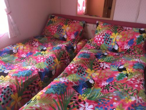 A bed or beds in a room at Golden palm resort skegness