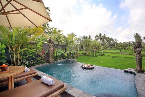 The swimming pool at or close to Madani Antique Villas by EPS