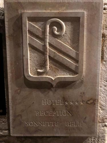 The logo or sign for the hotel