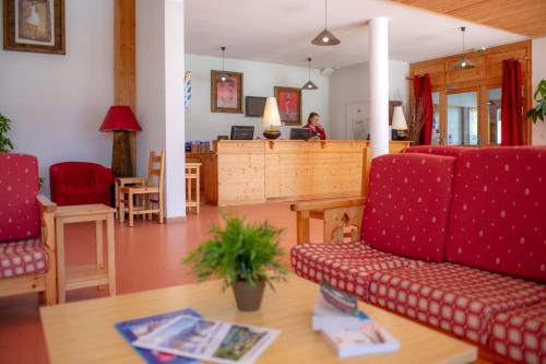 The lobby or reception area at Goélia - Les Chalets des Marmottes