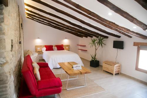 A bed or beds in a room at Apartamentos Turísticos La Casa Vieja