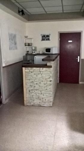 A kitchen or kitchenette at la grange de loghju