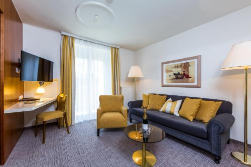 Ein Sitzbereich in der Unterkunft Hotel Goritschnigg