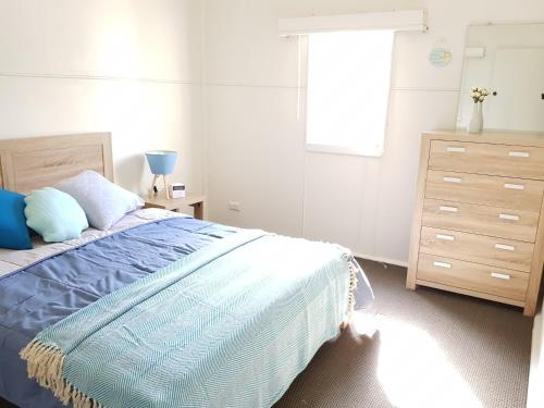 A bed or beds in a room at Dromana Holiday Beach House