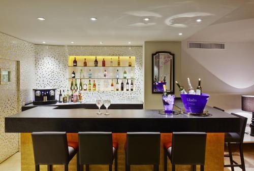The lounge or bar area at Hotel Palladium
