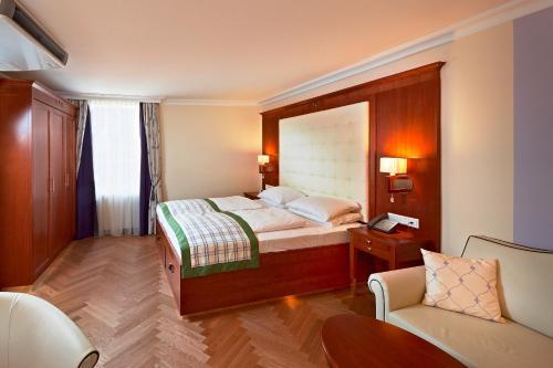 Ein Bett oder Betten in einem Zimmer der Unterkunft Hotel Elefant