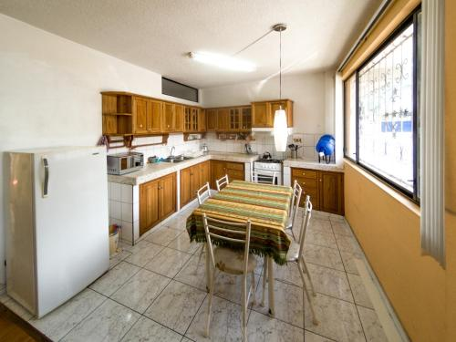 A kitchen or kitchenette at Mayra's Apartments and Spanish School