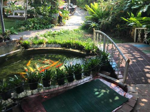 A view of the pool at Khoum Xieng Thong Boutique Villa or nearby