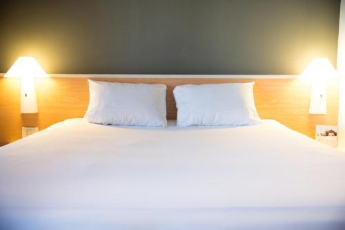 Letto o letti in una camera di Hotel Ibis Firenze Nord Aeroporto