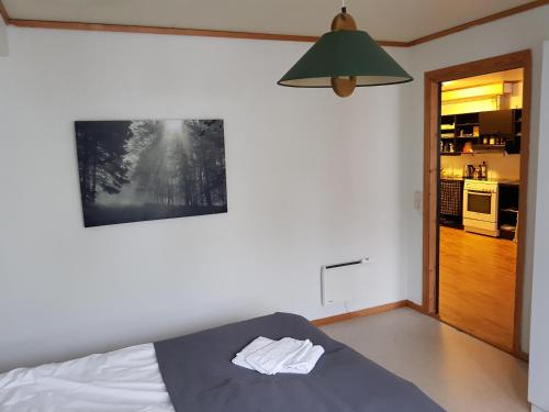 A bed or beds in a room at Volda Hostel, Bed and Breakfast AS