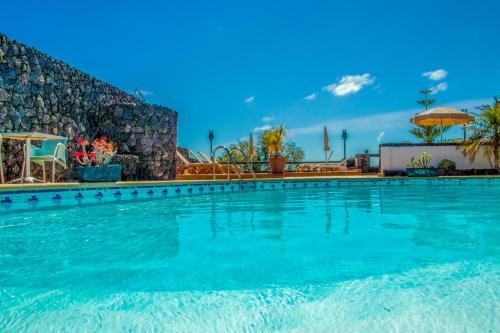 The swimming pool at or near El Hotelito Del Golfo