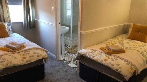A bed or beds in a room at The New Wellington