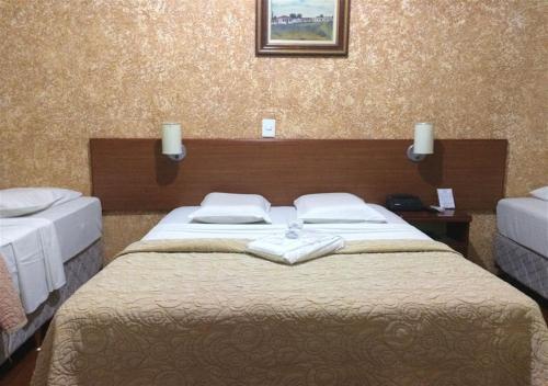 Cama ou camas em um quarto em Hotel Rafeli