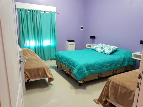 Una cama o camas en una habitación de Complejo EL ANGEL