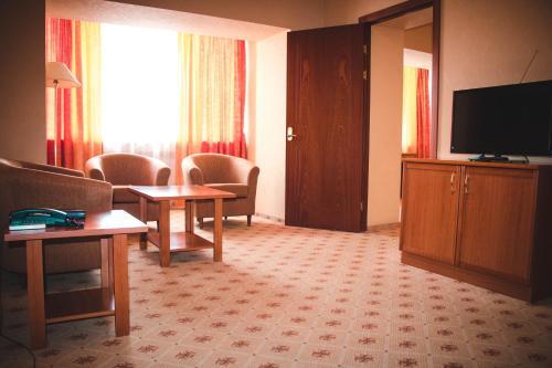 Телевизор и/или развлекательный центр в Отель Белый Лотос