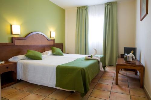 A bed or beds in a room at Apartamentos La Caleta