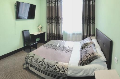 Кровать или кровати в номере Гостевой дом Милена