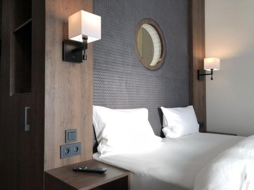 Ein Bett oder Betten in einem Zimmer der Unterkunft Hotel Smartino