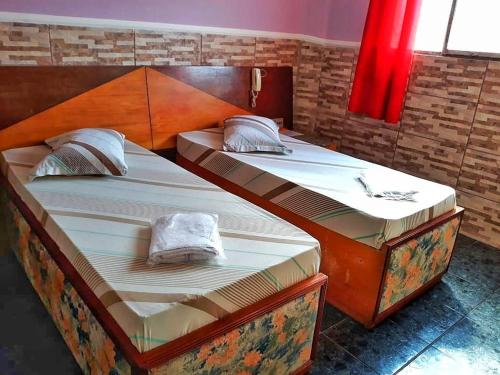 A bed or beds in a room at Center Hotel Ferraz